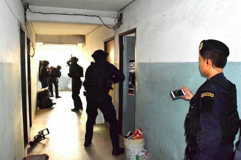 SWAT team members raid an apartment building in Bangkok's Ramkhamhaeng area Tuesday.