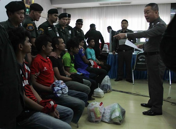 Maj. Gen. Chayapol Chatchaidej of Bangkok metro police talks to six men Tuesday  accused of plotting bomb attacks in Bangkok at the office of Crime Suppression Division.