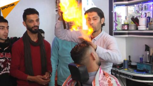 Gaza Barber Blazes Hair Styles with Fiery Method (Video)