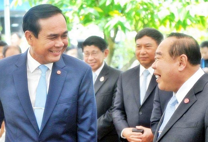Junta chief Prayuth Chan-ocha shares a laugh with his deputy Prawit Wongsuwan in an undated file photo.