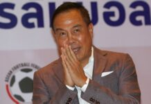 Football Association of Thailand President Somyot Poompanmuang gives a wai after a press conference in November in Bangkok. Photo: Sakchai Lalit / Associated Press