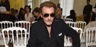 French rock singer Johnny Hallyday waits July 6, 2016, before Christian Dior's Haute Couture Fall-Winter 2016-2017 fashion collection presented in Paris, France. Photo: Zacharie Scheurer / Associated Press