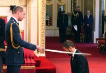 Former Beatle Ringo Starr, is made a knight by Britain's Prince William at Buckingham Palace during an Investiture ceremony in London on Tuesday. Photo: Yui Mok / Associeted Press