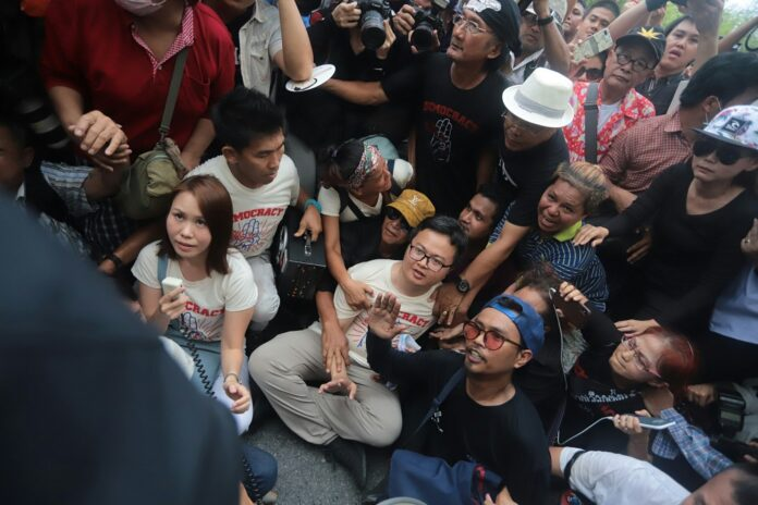 Police move in to arrest activist leader Nuttaa Mahattana and other protesters at Tuesday's rally.