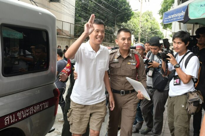 Ekachai Hongkangwan flashes the anti-junta 'three-finger salute' in May as he arrives at a Bangkok court.