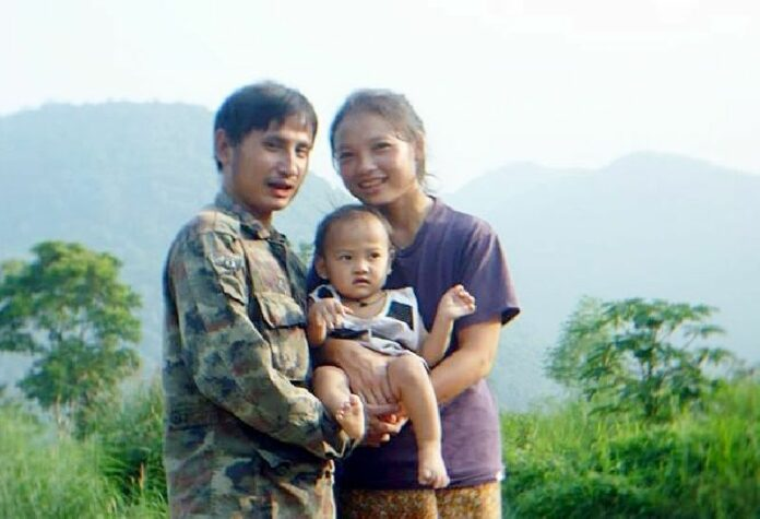 "Porlajee ""Billy"" Rakchongcharoen poses with his wife and child. Photo: Courtesy of his family"