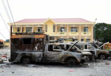 A row of charred vehicles is seen June 12 at the fire and police station in the south central province of Binh Thuan, Vietnam. Photo: Associated Press