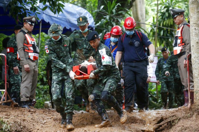 Thailand cave rescue efforts for trapped teenage soccer team pick up