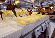 Piles of Styrofoam trays await durian-hungry customers Tuesday at the Or Tor Kor Market in Bangkok.