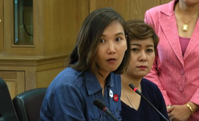 Rungroj Khwunkomol, aunt of the assaulted student, speaks at a press conference Friday afternoon.