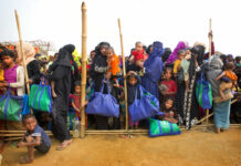 Rohingya Muslim women with their children stand in a queue outside a food distribution center in January at Balukhali refugee camp 50 kilometers (32 miles) from, Cox's Bazar, Bangladesh. Photo: Manish Swarup / Associated Press