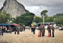 Police inspect the crime scene July 29 in front of the Buddha Mountain in Chonburi province.