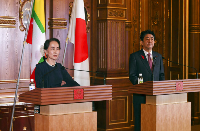 Myanmar's leader Aung San Suu Kyi delivers her speech beside Japanese Prime Minister Shinzo Abe during their joint press remarks following their bilateral meeting at the Akasaka Palace state guest house Tuesday in Tokyo. Photo: Toshifumi Kitamura / Associated Press