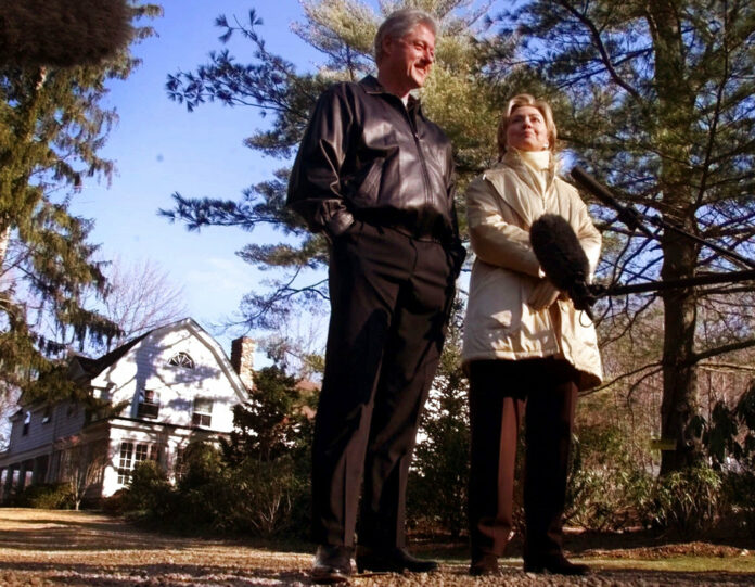 Bill and Hillary Clinton stand in the driveway of their new home in Chappaqua, New York, in a file photo. Photo: Associated Press