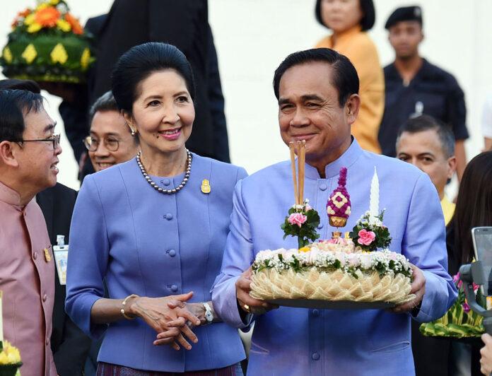 Naraporn Chan-ocha, left, and Gen. Prayuth Chan-ocha hold a krathong Thursday at Government House.