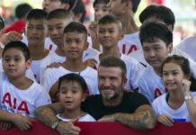 Retired footballer David Beckham poses Saturday for a group photograph during a sponsored promotional event in Bangkok. Photo: Gemunu Amarasinghe / Associated Press