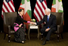 U.S. Vice President Mike Pence, at right, meets Myanmar leader Aung San Suu Kyi on Wednesday in Singapore. Photo: Bernat Armangue / Pool