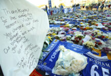 A personal salute is placed among tributes Friday at Leicester City football club Friday for Leicester Chairman Vichai Srivaddhanaprabha. Photo: Nigel French / PA
