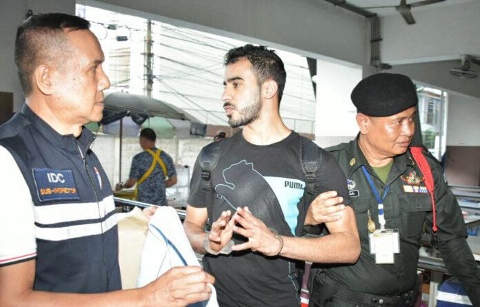 Hakeem Ali Mohamed Ali AlAraibi led in handcuffs at the Thai Criminal Court.