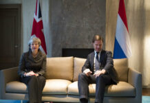 British Prime Minister Theresa May, left, and Dutch Prime Minister Mark Rutte pose for photographers at the start of a meeting Tuesday in The Hague, Netherlands. Photo: Peter Dejong / Associated Press