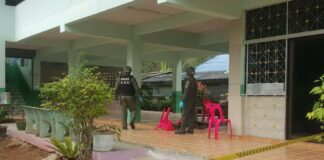 Police and soldier at the scene of an attack Thursday in a Pattani school.
