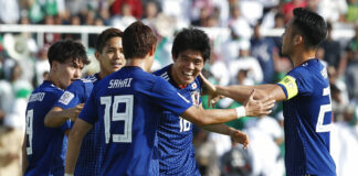 Japan's defender Takehiro Tomiyasu, second right, celebrates Monday after scoring the opening goal during the AFC Asian Cup round of 16 soccer match between Japan and Saudi Arabia at the Sharjah Stadium in Sharjah, United Arab Emirates. Photo: Hassan Ammar / Associated Press