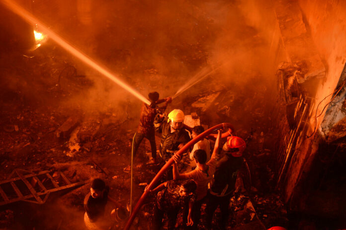 In this Wednesday, Feb. 20, 2019, photo, firefighters try to douse flames in Dhaka, Bangladesh. Photo: Associated Press