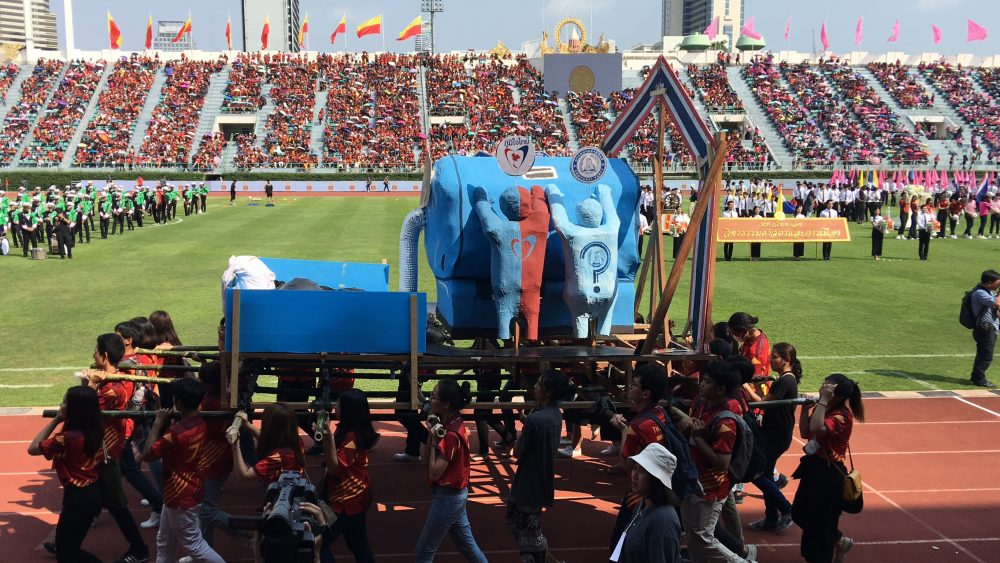 A float carried by students shows junta chairman Prayuth Chan-ocha literally leeching support from political parties including the Democrat and Bhum Jai Thai parties at Saturday's CU-TU game.