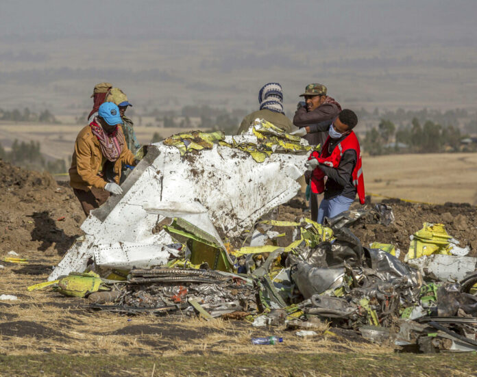 In this March 11, 2019, file photo, rescuers work at the scene of an Ethiopian Airlines flight crash near Bishoftu, Ethiopia. Photo: Mulugeta Ayene / Associated Press