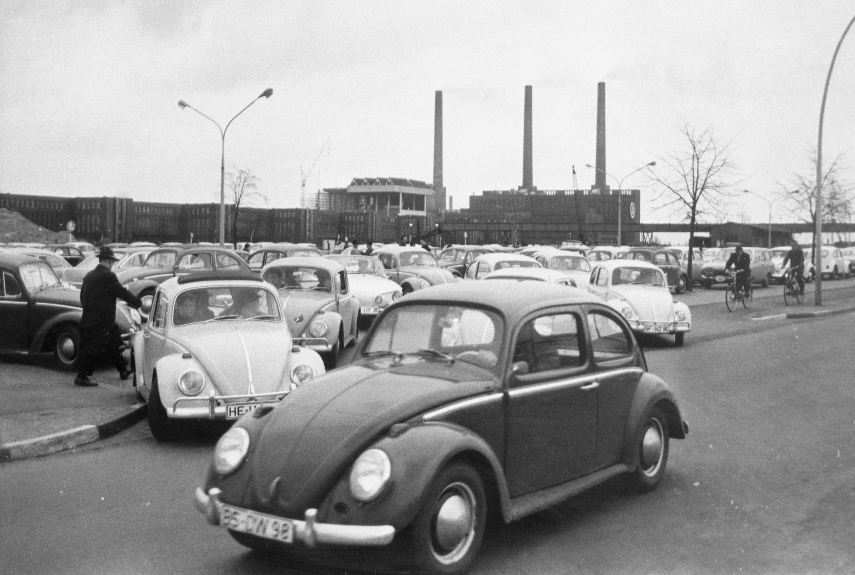 In this April 27, 1966 file photo, Volkswagen workers drive their Beetle cars from the parking lot on their way home at the end of a days work at the world's largest single auto plant, the Volkswagen factory (seen in background) in Wolfsburg, Germany. Photo: AP