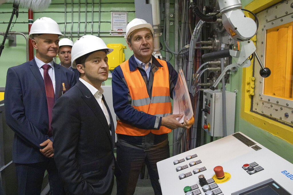 """Ukrainian President Volodymyr Zelenskiy, foreground, visits the """"new safe confinement"""" shelter that spans the remains of the Chernobyl nuclear power plant's Reactor No. 4, in Chernobyl, Ukraine, Wednesday, July 10, 2019. A structure built to confine radioactive dust from the nuclear reactor at the center of the 1986 Chernobyl disaster was formally unveiled on Wednesday. Photo: Ukrainian Presidential Press Office via AP"""