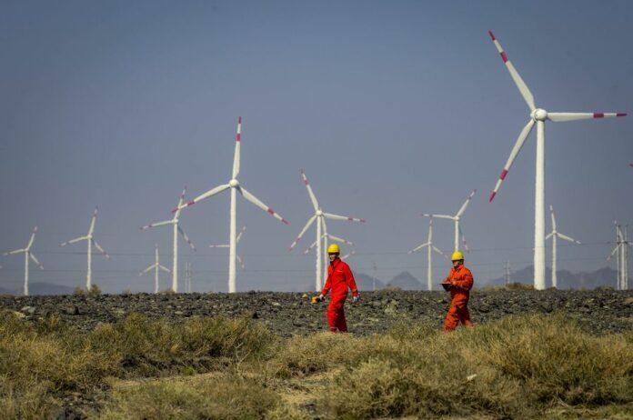 Workers check equipment at a wind power plant in Urumqi, northwest China's Xinjiang Uygur Autonomous Region, Sept. 18, 2018. Photo: Zhao Ge / Xinhua