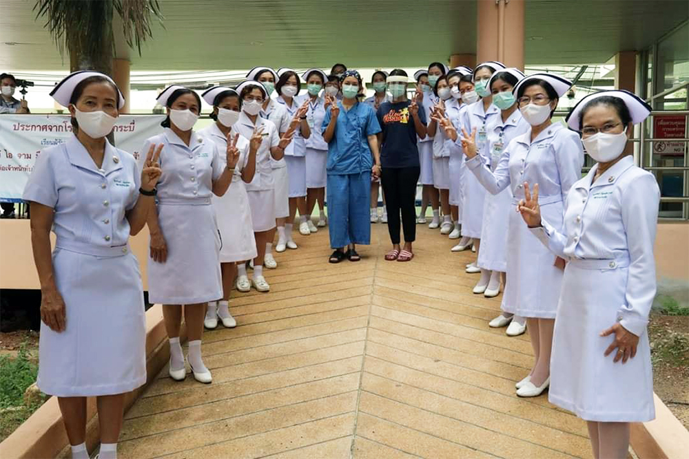 Nurses bid farewell to a patient who recovered from coronavirus in Krabi province on May 12, 2020.