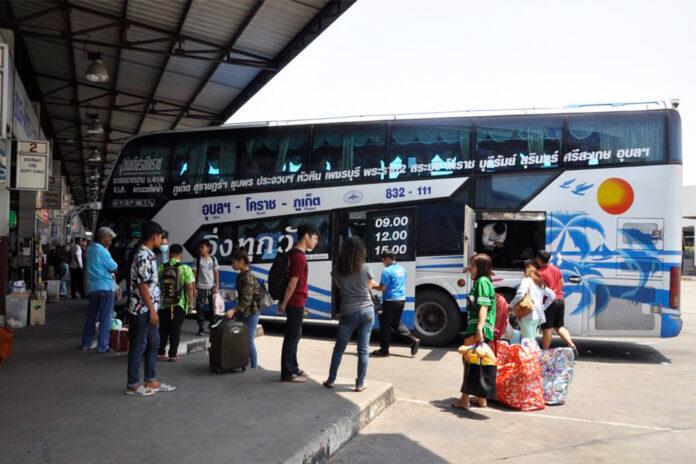 Passengers wait for intercity buses at Korat Bus Terminal on April 8, 2020.