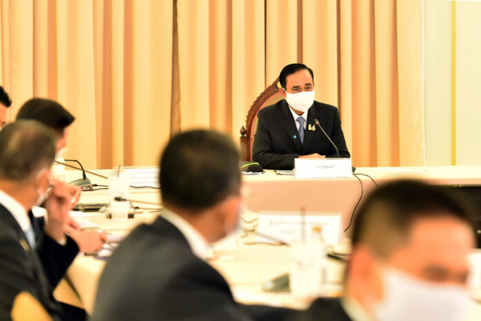 PM Prayut Chan-o-cha chairs a government's pandemic response center meeting on May 15, 2020.